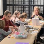 """An image of families creating their own museums in the """"Make Your Own Museum"""" Kids Club Craft event at OCA Mocha."""